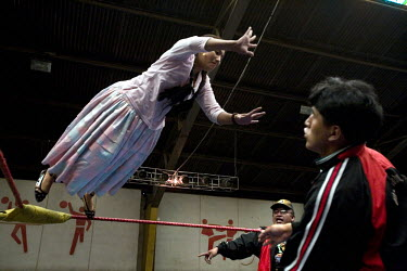 18 year old wrestler Gloria Esperanza (fighting name), Esperanza Gomez (real name) practices a jump from the ropes before a fight at the Multifuncional building. Esperanza is a Cholita, a wrestler of...
