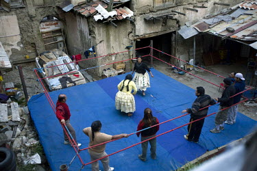 38 year old wrestler Carmen Rosa (fighting name), Polonia Ana Choque Silvestre (real name), centre (in yellow), fights with fellow wrestler 26 year old Yolanda La Amorosa (fighting name), Veraluz Cort...