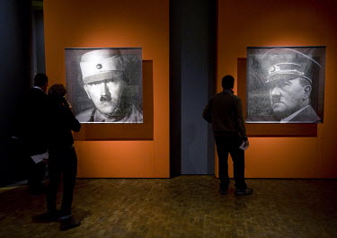 Visitors look at portraits of Adolf Hitler at the exhibition Hitler and the Germans, Nation and Crime at the German Historical Museum in Berlin. The exhibition seeks to answer the question of why so m...