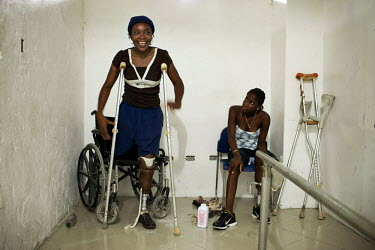 A woman smiles as she tries a prosthetic leg at an orthopaedic workshop for amputees, run by aid agency Handicap International. She lost both her legs when a magnitude 7.0 earthquake struck Haiti on 1...