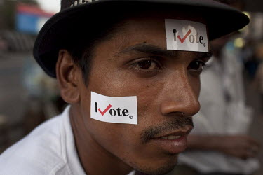 A man with stickers attached to his face that read iVote. This was part of a campaign to encourage people to vote in Burma's first elections since 1990. However, the main pro-democracy party, the NLD...
