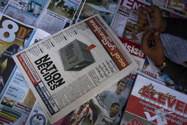 An election special newspaper on sale at a newsstand ahead of Burma's first multi-party elections since 1990. However, the main pro-democracy party, the NLD (National League for Democracy), boycotted...