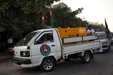A convoy of vehicles campaigning for the government-backed USDP (Union Solidarity and Development Party) in the old capital Rangoon (Yangon) in the lead up to Burma's first multi-party election since...