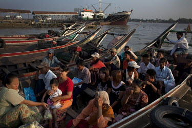 People wait to cross the Rangoon (Yangon) River in one of the regular passenger boat services that ply the route.