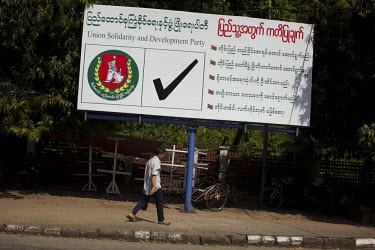 An election poster for the government-backed USDP (Union Solidarity and Development Party) in the old capital Rangoon (Yangon) prior to Burma's first multi-party election since 1990. However, the main...