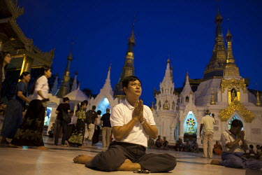 A man offers prayers in the Shwedagon Pagoda.