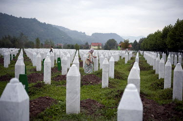 Relatives mourn at the graveside of victims of the Srebrenica massacres when Bosnian Serb forces, led by general Ratko Mladic, murdered 8,000 mainly Bosnian Muslim men and boys. The cemetery, official...