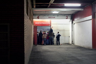 Fans at Red Star Belgrade's stadium watch a game crowding an entry gate to the stands. Witnesses have reported seeing former Bosnian Serb general Ratko Mladic attending football matches at this stadiu...