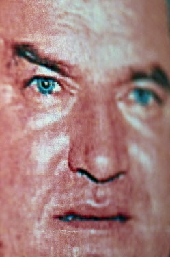 A wanted poster for former Bosnian Serb general Ratko Mladic. He is one of the most sought after suspects from the Bosnia conflict. He has been indicted by the UN war crimes tribunal on charges of gen...