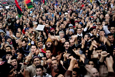 Crowds at a Friday prayer and protest against the Gaddafi regime in central Benghazi. Benghazi is now in the hands of the rebels. On 17 February 2011 Libya saw the beginnings of a revolution against t...