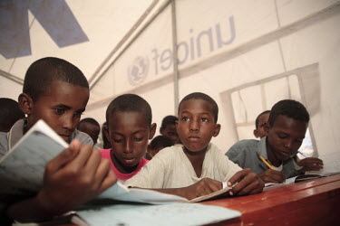 Children studying in the UNICEF school in Dami IDP (internally displaced persons) camp.