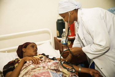A female member of the medical staff takes the blood pressure of a woman patient in Edna Adan Hospital in Hargeisa.