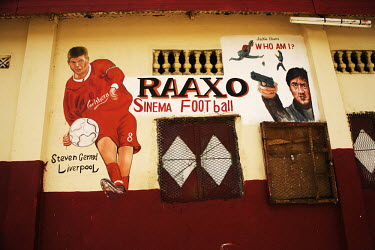 A mural of football player Steven Gerrard and a hand painted film poster of Jackie Chan painted on a wall in Hargeisa.