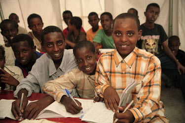 Children studying in the UNICEF school in Dami IDP (internally displaced people) camp.