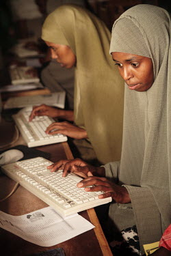 Women work on computers at the Havoyoco/ARV Centre for displaced Somali youth.
