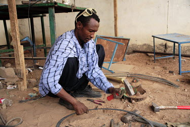 A man works metal at the Hargeisa, Havoyoco ARV Centre for displaced people.