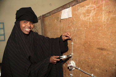 A young woman learns some practical skills at the Havoyoco/ARV Centre for displaced Somalis.