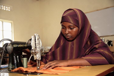 A young woman studies tailoring at the Havoyoco/ARV Centre for displaced Somali youth.