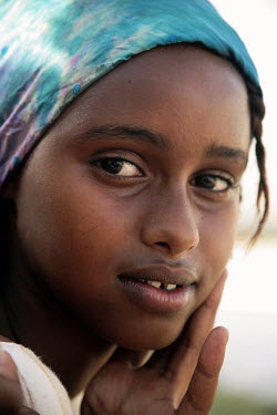 A portrait at Socsa (Somaliland Culture and Sports Association)of a young basketball player.