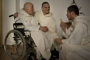 93 year old father Norbert talks to novice monks Silvan and Jeronimo at the Carthusian monastery of Serra San Bruno.
