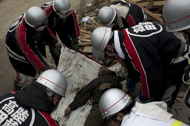 Rescue workers lift bodies onto the back of a truck. Thousands of people died in this small town which ran out of body bags. On 11 March 2011 a magnitude 9 earthquake struck 130 km off the coast of No...