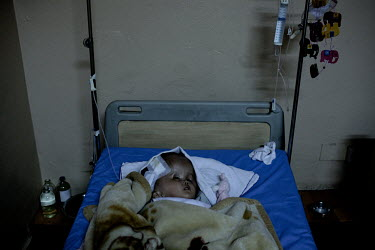 Victoria lies in a bed two days after surgery when 1.5 litres of fluid was drained from her head at the Annapurna Neurological Institute in Kathmandu. 19 month old Victoria (formerly named Ghane) was...