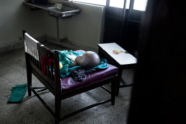 Victoria lies on a chair in the back room of the public maternity hospital Paropakar in Kathmandu. This photograph was published in Danish newspaper Berlingske in September 2010 and caught the attenti...