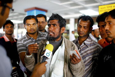 50 year old Mohummad Ali is interviewed at Dhaka airport having just returned from Libya. He left Dhaka 17 months ago. He was a farmer in his village. His poverty forced him to migrate to Libya. He sp...