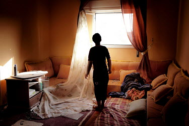 A young boy stands in the living room of a house that was partly destroyed by a missile fired by pro-Gadaffi forces. According to the family living in there no rebels were fighting from the house and...