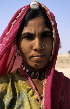 A woman wearing tribal jewelry.