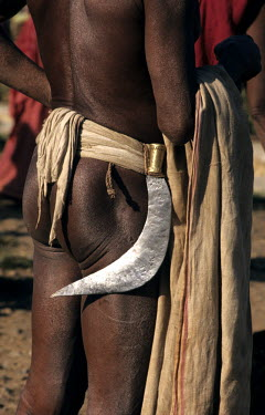 Dongaria Kondh tribal man carries a sickle from his belt.