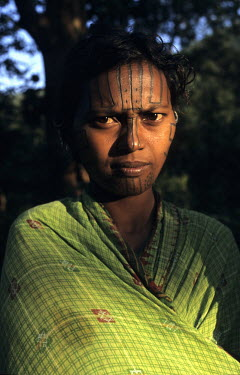 A Desia Kondh tribal woman, with a tattooed face.
