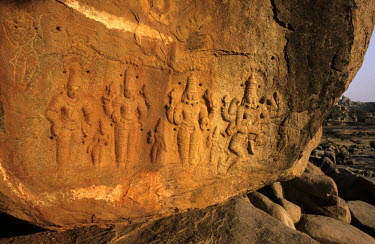 Figures carved onto a boulder on the bank of the Tungabhadra River that date from the time of the Vijayanagar Empire.