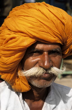 A Rajasthani man in a turban and sporting a grand moustache.
