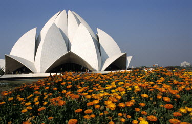 Flowers in bloom outside the Lotus Temple, a Bahai house of worship, in Bahapur.