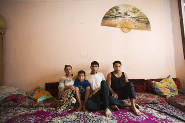 40 year old Roma widow Fatima Marolli with her three sons in their living room/bedroom in Vranjevac. During the NATO bombing in 1999 the whole Roma community escaped to a temporary camp in Krusevac an...