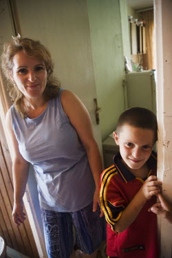 A woman and her son, internally displaced Kosovo Albanians (IDPs), who are living in the Old Orphanage Collective Centre in Mitrovica. Some 28 families whose houses were destroyed during and after the...