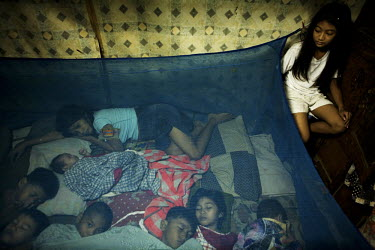 The Esponilla family sleep in their house in Santo Nino, Manila. Bhona and Charito Esponilla have seven children and live in 20 square meters of space. Poverty and overpopulation are closely connected...