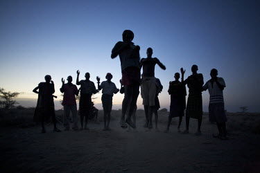 Turkana men and women leap into the air during an 'Edunga' dance held in the evening near Kataboi. Northern Kenya is in the midst of a severe drought, and in the absence of safe drinking water and foo...