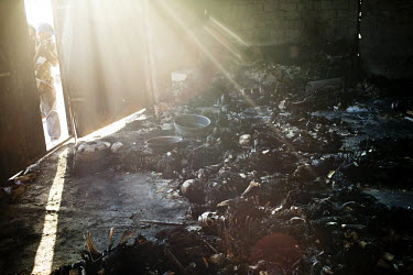 Burned remains of corpses inside a warehouse. At least 50 people where found dead in a complex neighbouring the headquarters of the Khamis brigade in Tripoli. According to two survivors, the people wh...