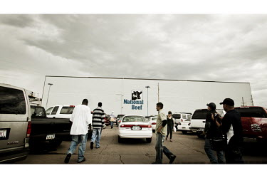 Members of the workforce, largely made up of migrant workers, make their way  through the car park to the National Beef meat packing plant in Dodge City, Kansas. This facility kills and processes betw...