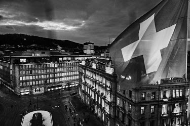 The Swiss flag flies on the roof of luxury hotel Savoy Baur en Ville, overlooking Paradeplatz, the symbolic centre of the Swiss banking industry, showing the headquarters of Switzerland's two largest...