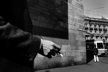 A man holds a cigarette as he approaches the Paradeplatz, the symbolic centre of the Swiss banking industry in the centre of Zurich. The Swiss banking industry holds an estimated 6,352 billion Swiss F...