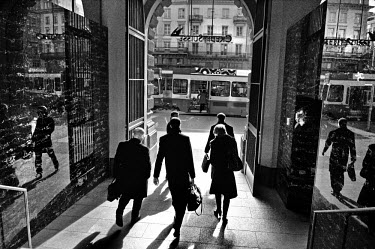 Group of businessmen and women leaving the Credit Suisse headquarters on Paradeplatz, the symbolic centre of the Swiss banking industry in central Zurich. The Swiss banking industry holds an estimated...