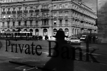 A reflection, in the window of a private bank, of the headquarters of Credit Suisse one of Switzerland's largest banks in Paradeplatz, the symbolic centre of the Swiss banking industry. The Swiss bank...