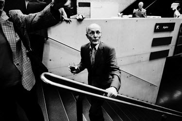 A shareholder at the Credit Suisse AGM walks up a flight of stairs holding a glass of wine. The Swiss banking industry holds an estimated 6,352 billion Swiss Francs (USD 7,000 billion) in assets, more...