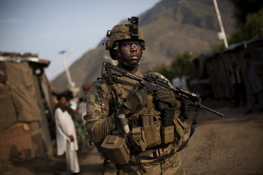A US Army soldier from Gundog Company, 2-35 Infantry Regiment on patrol in the village of Watapur in the Pech Valley.