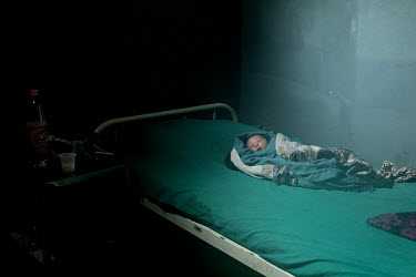 A newborn baby boy lies on a bed at the public maternity hospital. A state program has been instigated to enable women to have hospital births instead of home births and thereby reduce infant and mate...