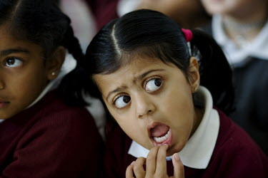 A pupil at the Krishna-Avanti primary school in Harrow, North London, the first state-funded Hindu faith school in Britain.