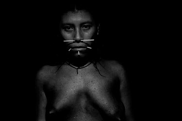 An indigenous woman poses in the Maraca Yanomami community on the Siapa River.